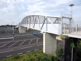 Footbridge over car park and railway, St Andrew's church spire in the distance | Anne Langley