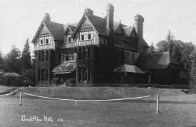 The original Great Alne Hall. Knocked down in the mid 1930s. A mock Tudor building, a dog lounges on the patio. | Warwickshire County Record Office reference PH(N) 404/11