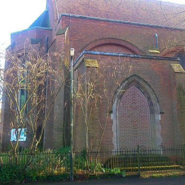 Bricked up doorway in a pointed arch to a red brick church with stone dressings   Sheila Bridge