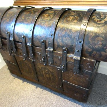 Painted wooden chest with iron bands and several locks | Anne Langley