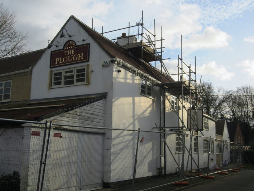 White painted 2-storey building with scaffolding and sign 'The Plough' | Anne Langley