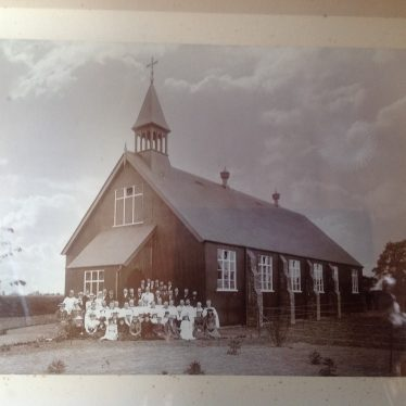 Group of around 50 people outside a church with 6 bays, a porch, a tin roof with a small bell-tower. | St Peter's Church archive