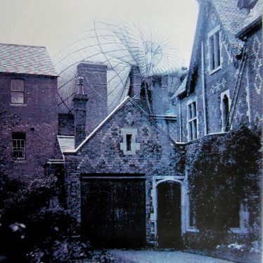 Partially collapsed balloon on the roof of a patterned brick building with garden in the foreground | Courtesy of Warwickshire County Council, Leamington Library Local Studies Collection (Windows on Warwickshire website), reference T 394.25.9 6085