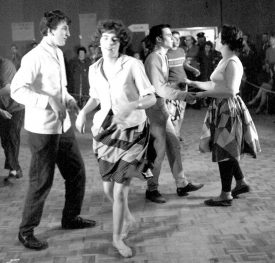 Couples dancing in a hall | Warwickshire County Record Office reference PH(N), 600/779/2.