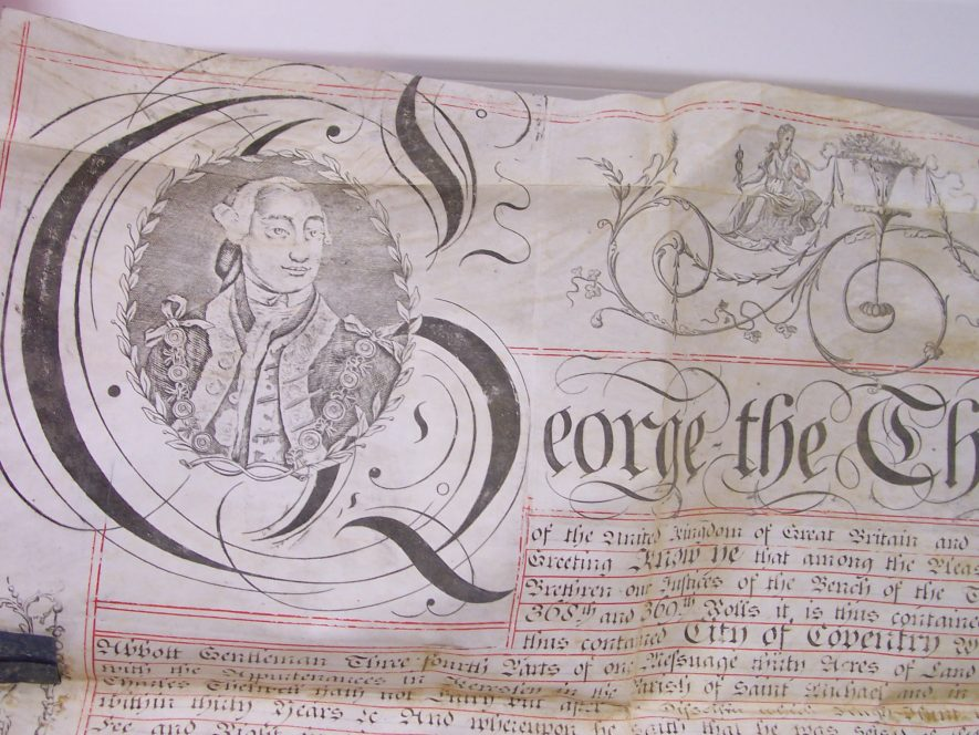 Common recovery document. Portrait of the King and elaborate penwork. | Warwickshire County Record Office reference CR4068/1