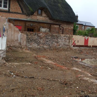 The Red Lion site September 2015. Not much left, but a view of a cottage not seen for a good while! | Photo by Benjamin Earl.
