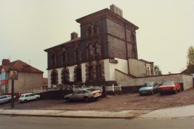 The Governor's House - view from the road, with cars parked in front.   Photograph by Tony Talliss. Warwickshire County Record Office reference PH1272 (May 1988).