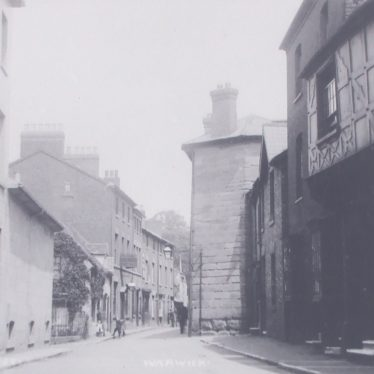 Barrack Street, looking towards Northgate Street. An almshouse is on the right, with the Hare and Hounds on left after the police station. | Warwickshire County Record Office reference PH343/54