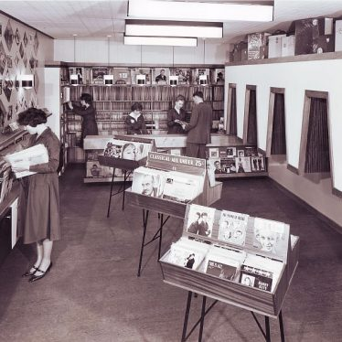 Display of gramaphone records and listening booths in Taylors of Nuneaton - a few customers looking at LPs | Picture courtesy of Nuneaton Memories