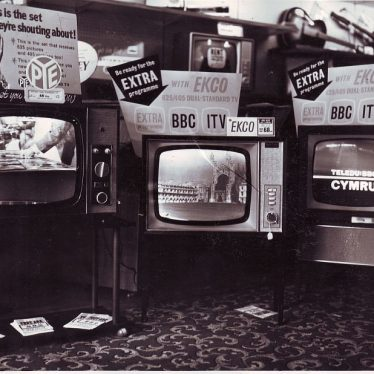 TVs offering BBC, ITV and 'Get ready for the EXTRA programme' on display in Taylors of Nuneaton | Picture courtesy of Nuneaton Memories