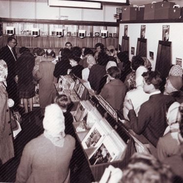 Display of gramaphone records, listening booths and a crowd of people including women in headscarves | Picture courtesy of Nuneaton Memories