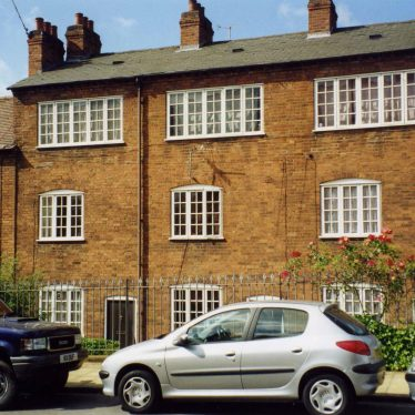 Red brick 3-storey terrace house with extra wide windows on the top floor | Anne Langley