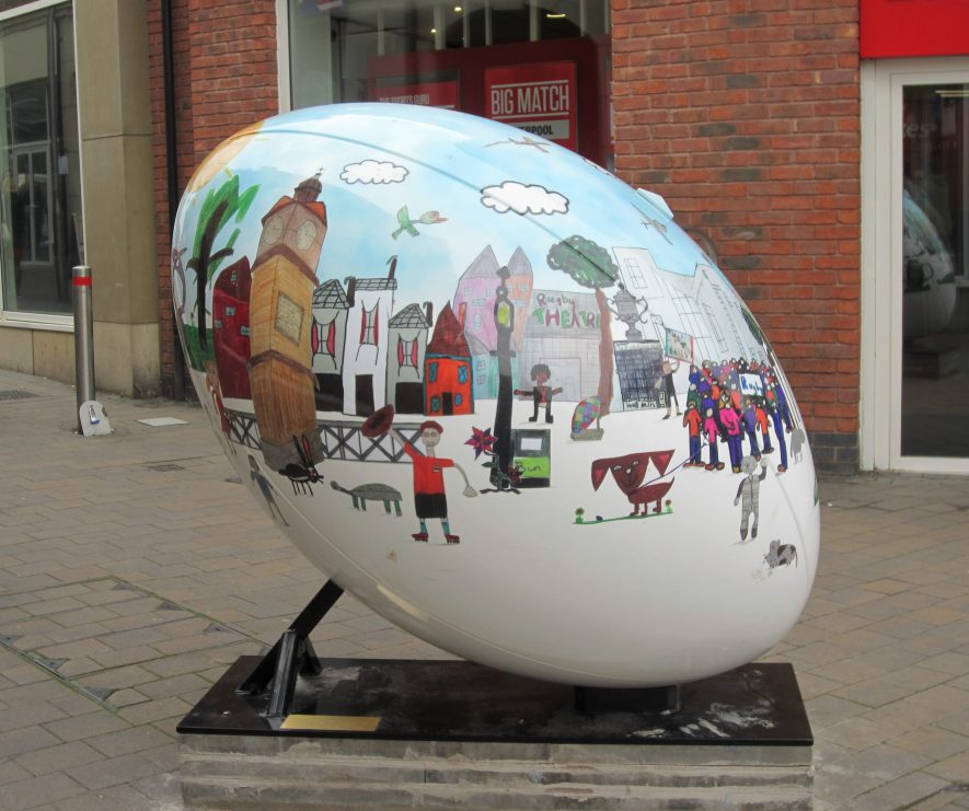 Huge rugby ball with children's drawings of Rugby scenes | Anne Langley