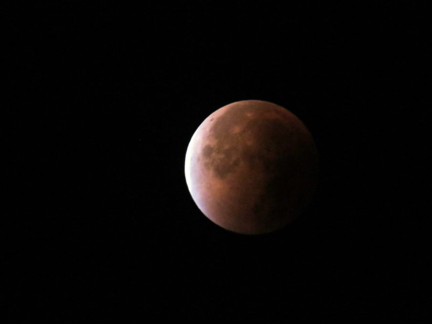 Reddish moon largely eclipsed | Larry Wooding