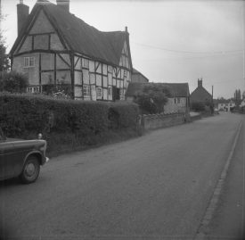 The house in 1967. The roof has a cloth-like texture. | Warwickshire County Record Office reference PH(N)212/56/1/49. Part of a photographic survey of Warwickshire parishes conducted by the Women's Institute.