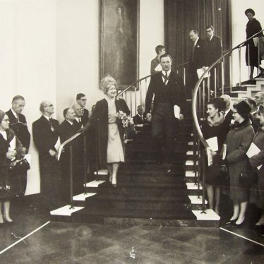 The Queen Mother descends the staircase at Shire Hall. | Warwickshire County Record Office reference PH143/1162a