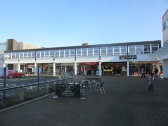 Talisman Square, looking to the east, showing the Talisman sign above the café and jewellers