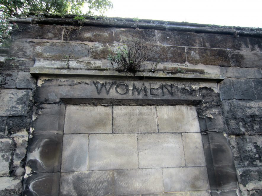 Plain stone doorway in wall headed 'Women' and blocked up with stones | Anne Langley