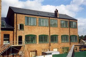 3-storey brick building with large green painted windows and slate roof | Anne Langley