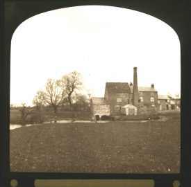 Mill buildings including tall chimney beside river | Courtesy of Warwickshire CC, Rugby Library Local Studies Collection; Warwickshire County Record Office reference PH827/5/30; photographer Rev. E. Dew