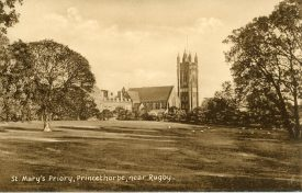 This is a photograph showing St Mary's Priory, Princethorpe with a view over the grounds to the Chapel and other buildings taken from the North West | Image courtesy of Princethorpe College