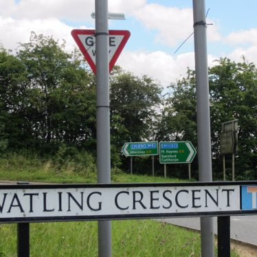 Road sign 'Watling Crescent' with direction signs on the A5 in the background | Anne Langley