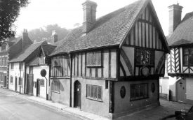 A black and white photograph of Oken's House, a large timber-framed house on Castle Street, Warwick. | Warwickshire County Record Office reference PH599/886