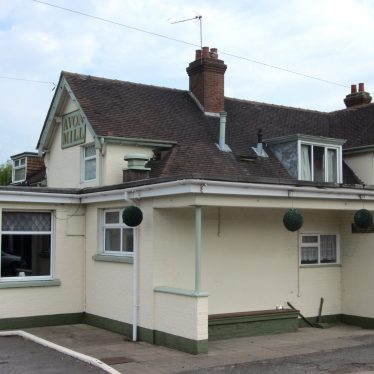 Cream-painted 2-storey building with tiled roof | Anne Langley