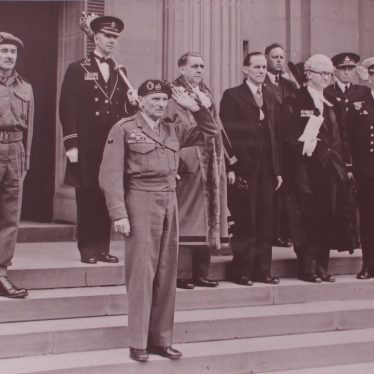 Field Marshal Montgomery taking the salute from the steps of the Council House in Coton Road. | Warwickshire County Record Office reference PH882/4/2562