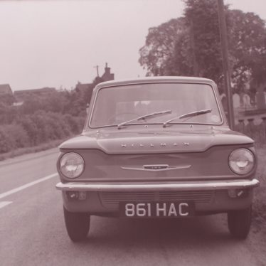 Photograph of the new Hillman Imp on road by Ansley Church, near Nuneaton. | Warwickshire County Record Office reference PH 882/2/1362