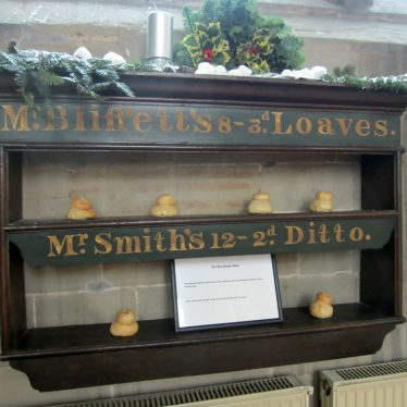 Shelves with model cottage loaves on them labelled: Mr Blissett's 8 - 3d Loaves. Mr Smith's 12 - 2d Ditto. | Photo courtesy of Anne Langley