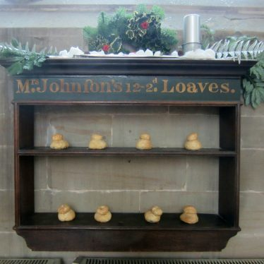 Shelves with model cottage loaves on them titled: Mrs Johnson's 12 - 2d Loaves. | Photo courtesy of Anne Langley