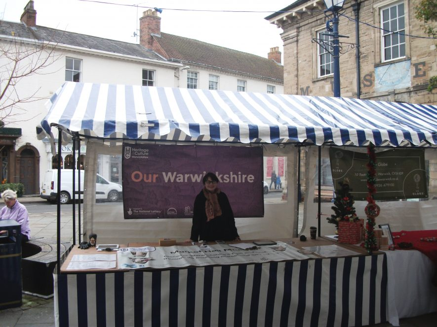 One of our staff, Abi, braving the cold to man our market stall, helping us to spread the word about what we're getting up to. | Picture courtesy of Bronwen Williams