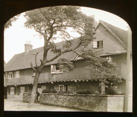 House with jetted 2nd storey covered in render with pine tree in front | Courtesy of Warwickshire CC, Rugby Library Local Studies Collection; WCRO PH827/5/33; photographer Rev. E. Dew