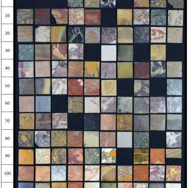 Photograph of the specimen marble tiles laid out in a grid which allows cross referencing to the list. | Warwickshire County Record Office reference CR1886_Box807_51