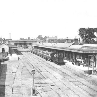 This is a black and white photograph of Coventry railway station circa 1865, showing a train at one of the platforms. | Image courtesy of warwickshirerailways.com