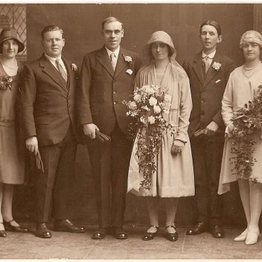 A photograph by George Redding. The wedding party consists of bride and groom, with a couple either side. | Image courtesy of Alistair Redding