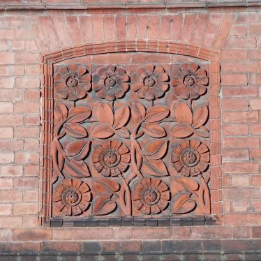 The floral design. A relief on a brick wall. | Photo courtesy of Iain Hodgson