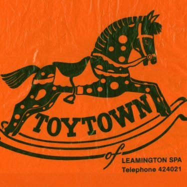 Detail from Toytown carrier bag. A rocking horse is on an orange background, with 'TOYTOWN' in capitals between the rockers. | Image courtesy of Leamington Spa Art Gallery & Museum (Warwick District Council).