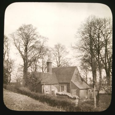 Small building (mostly 1-storey) set amongst bare trees | Courtesy of Warwickshire CC, Rugby Library Local Studies Collection; WCRO PH827/5/29; photographer Rev. E. Dew
