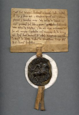 One of the oldest documents in the Warwickshire County Record Office collection, dated between 1100 and 1119. The seal is cushioned for conservation, as seals are liable to crack. | Warwickshire County Record Office reference CR1886/Cupboard4/Topshelf/W6