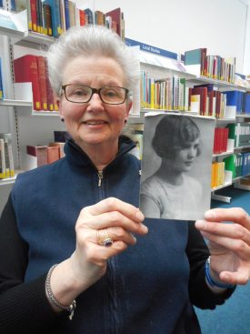 Gladys Ingram's daughter, holding her mother's photo. | Image courtesy of Sarah Hann