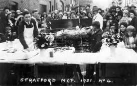 Pig roast at the Stratford Mop. 1931 | Warwickshire County Record Office reference PH352/172/24