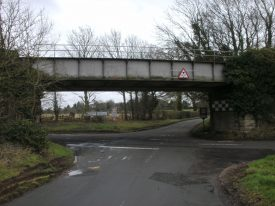 The Hill Wootton bridge of today no longer has a reputation for the way it sways when a train passes over it, but is notorious for blocking the view of oncoming traffic for anyone trying to negotiate the crossroads beneath. | Image courtesy of Richard Neale