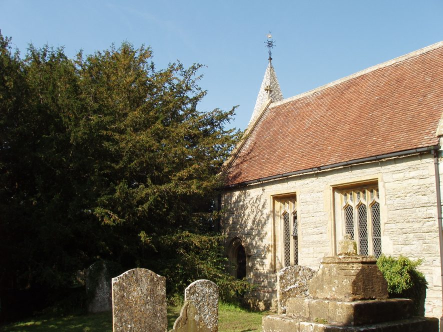 Churchyard with tombstones, yew tree and one-storey stone church with tiled roof and small steeple with weathervane | Maureen Harris