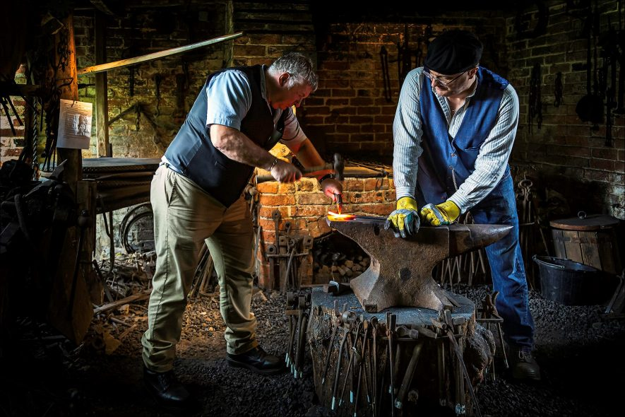 Forging a piece of metal in the blacksmith's shop at Chedham's Yard, Wellesbourne. | Image supplied by Gary Stocker. A visitor to Chedham's Yard took it whilst he was on duty, and said that the yard could use it for publicity.