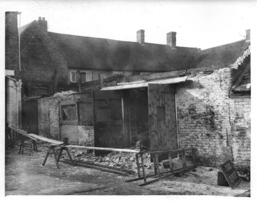 Demolishing the Garage and Coal Store at the Bull Inn, Southam in 1965 | Image courtesy of John Slack