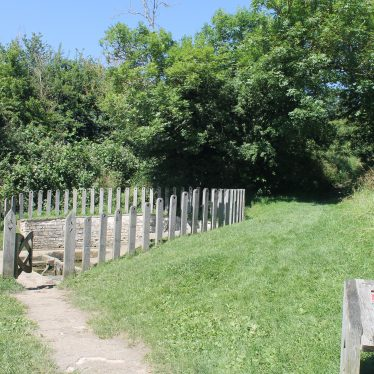 A path leading to the site of the Holy Well at Southam, surrounded by wooden fence | Image courtesy of L Caves
