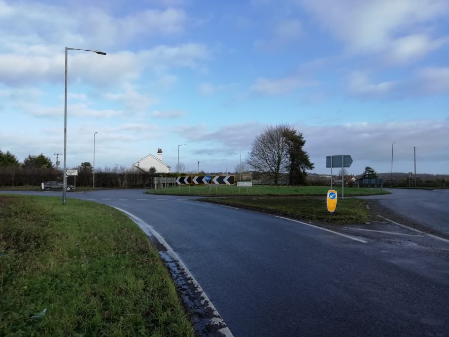 Road with grass verge on either side and road junction | Image courtesy of  Gary Stocker