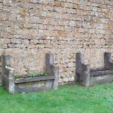 A pair of stone benches set within or up against a building on Sandpits Road, Middle Tysoe